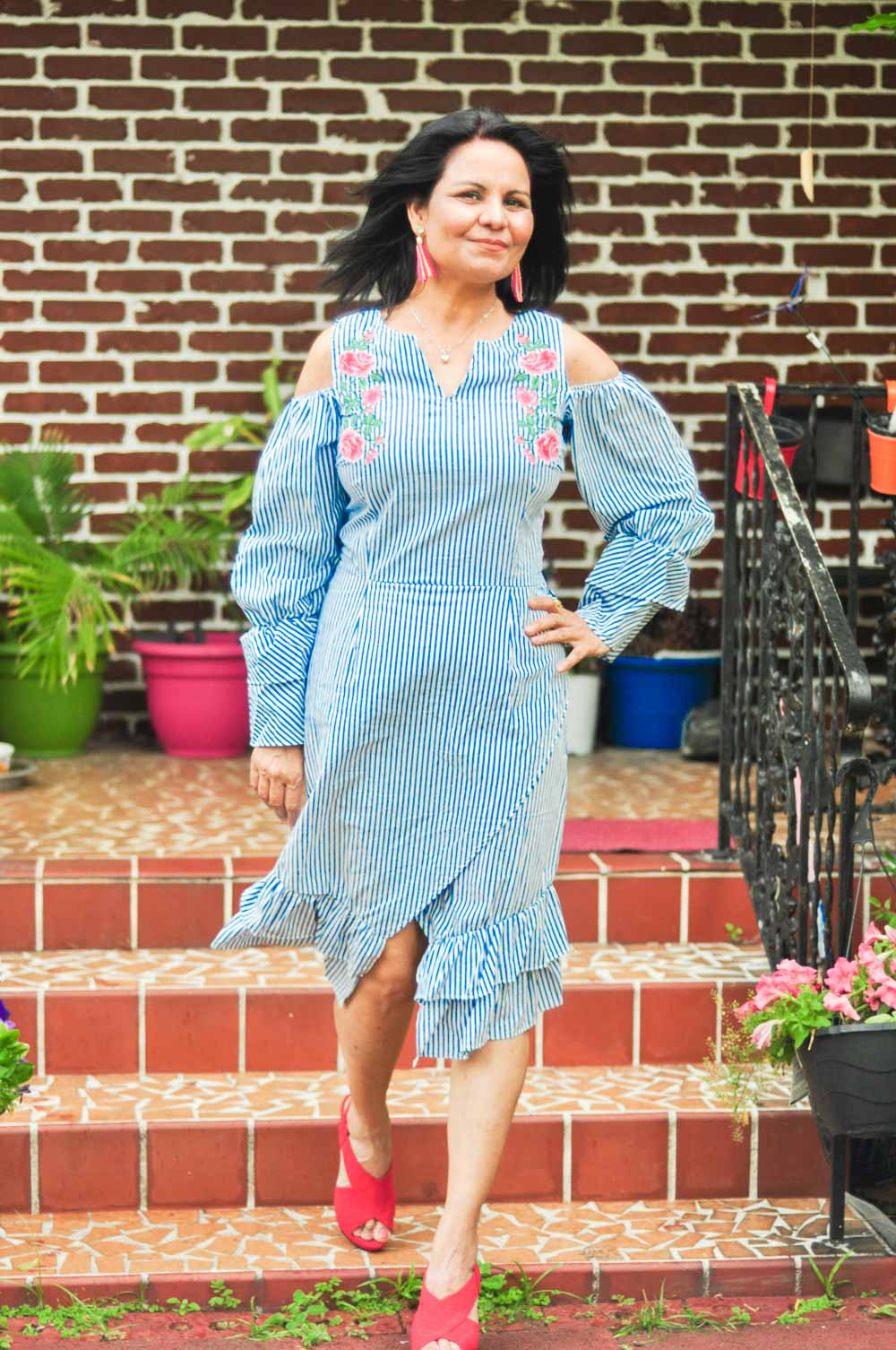 blue striped dress and statement earrings for spring or summer outfit